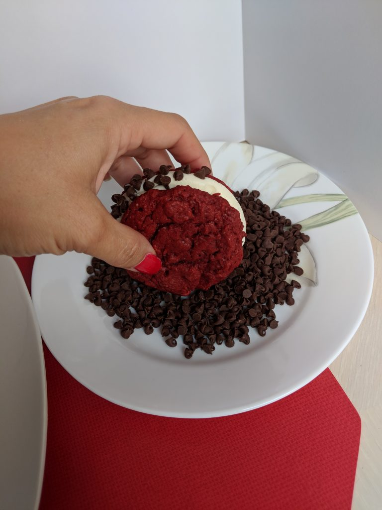 Dip red velvet cake mix cookie in mini chocolate chips to add ants to your Ant-Man cookie