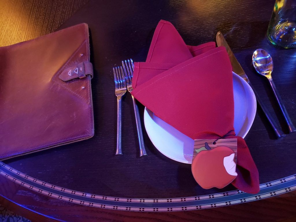 The place setting at Storybook Dining Snow White Character meal sets a charming beginning.