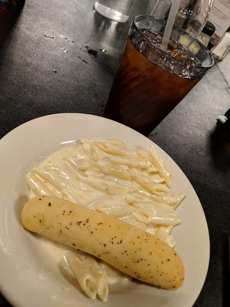 Pasgetti's alfredo pasta and breadstick