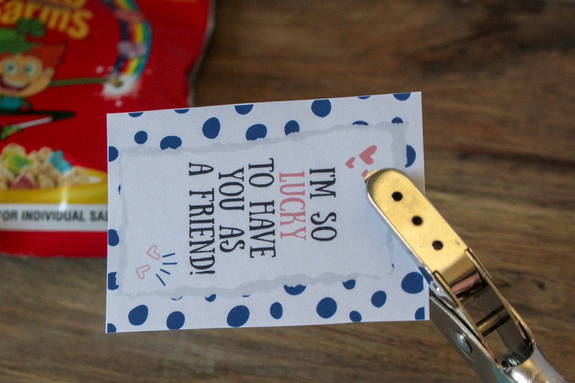 Use the hole punch to put a hole at the top of the printable cereal Valentines.