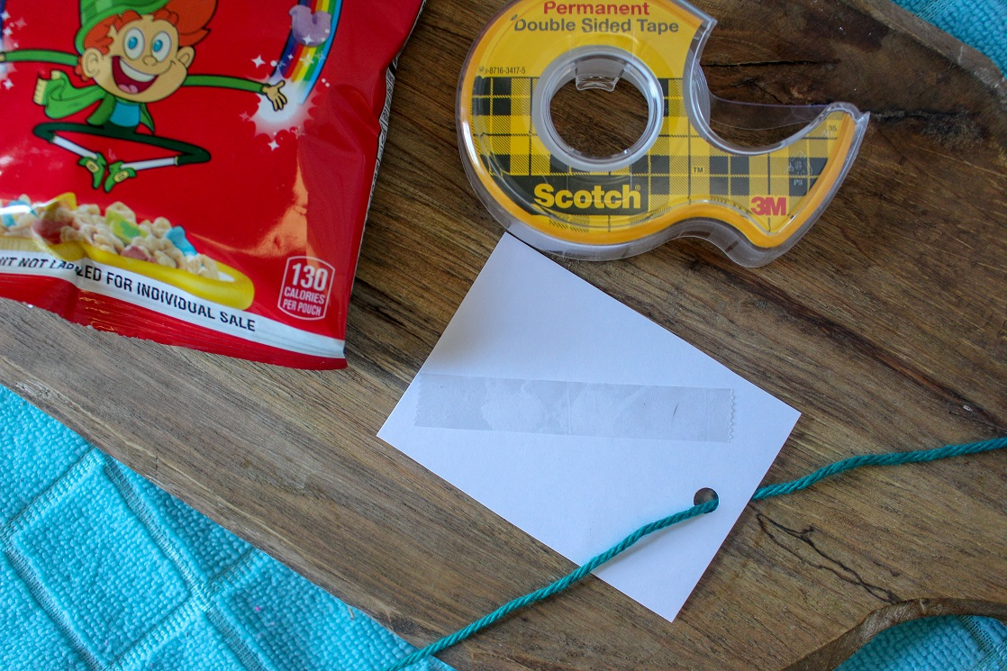 Use double sided tape or glue dots to help keep the printable cereal valentines in place.