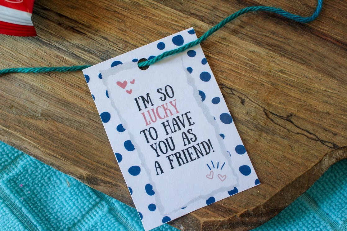 String yarn through the hole in the printable cereal Valentines.