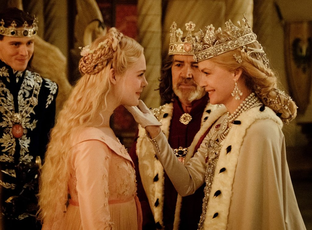 Aurora (Elle Fanning) and Queen Ingrith (Michelle Pfeiffer) share a moment at their first meeting.