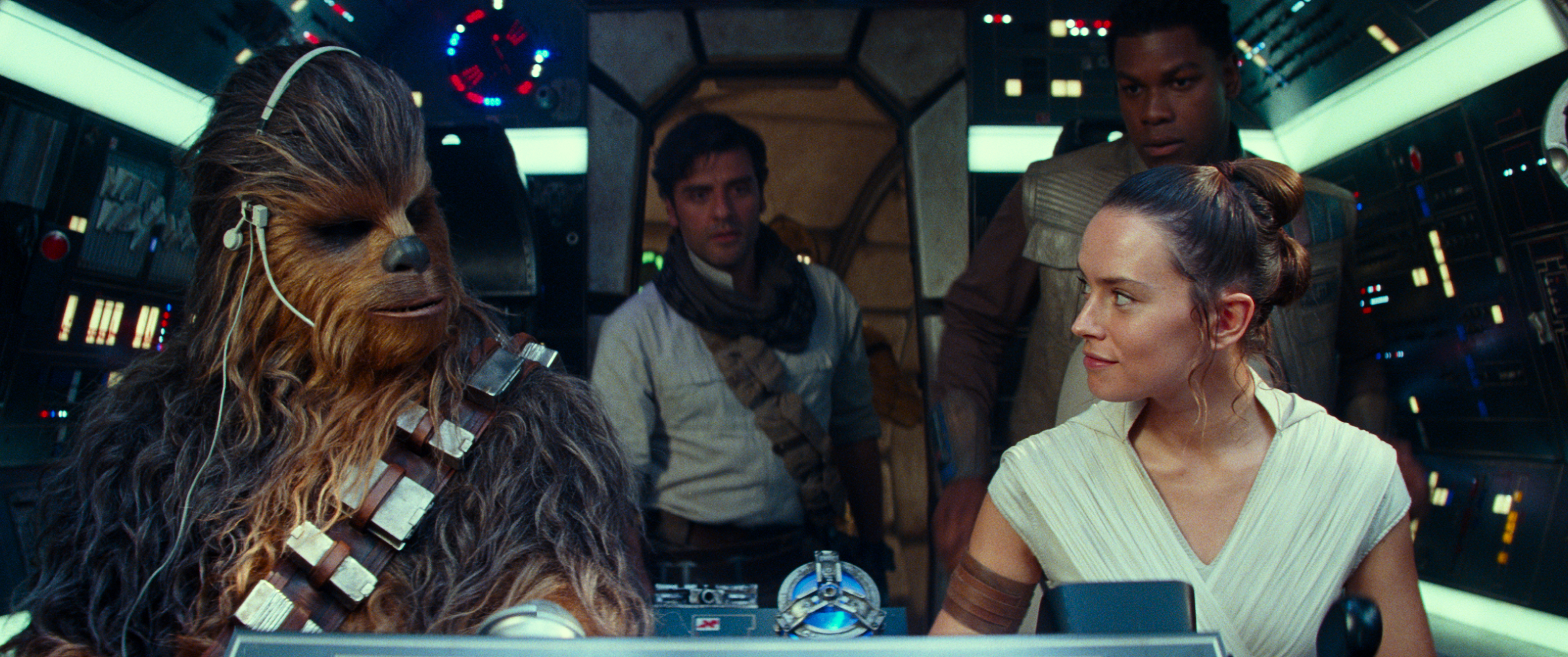 Star Wars: The Rise of Skywalker is one of the must see movies in theaters on Christmas day. Photo of Joonas Suotamo is Chewbacca, Oscar Isaac is Poe Dameron, Daisy Ridley is Rey and John Boyega is Finn in STAR WARS:  THE RISE OF SKYWALKER