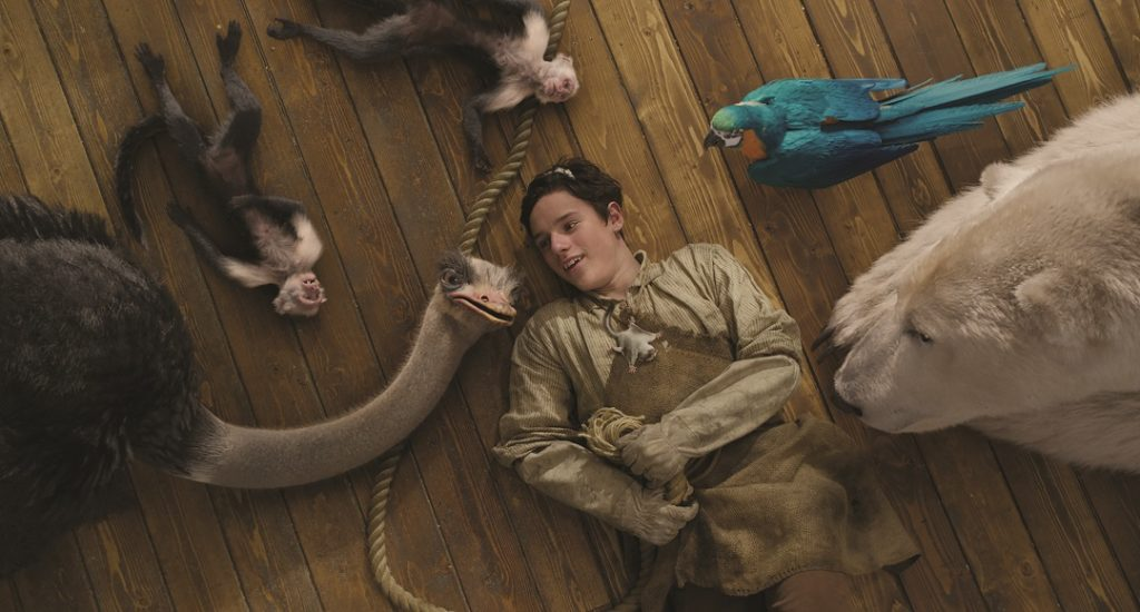 """(clockwise, from bottom left) Ostrich Plimpton (Kumail Nanjiani), monkeys Elliot and Elsie, parrot Polynesia (Emma Thompson), polar bear Yoshi (John Cena), Tommy Stubbins (Harry Collett) and sugar glider Mini (Nick A. Fisher) in """"Dolittle,"""" directed by Stephen Gaghan."""