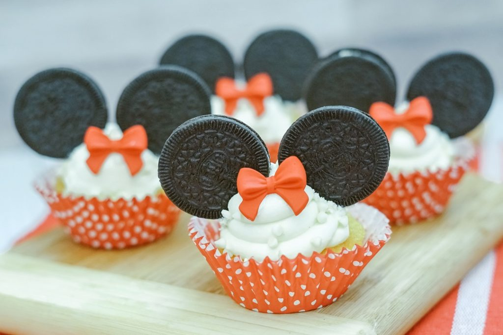 Minnie Mouse cupcakes made with mini Oreos and Wilton candy bows.
