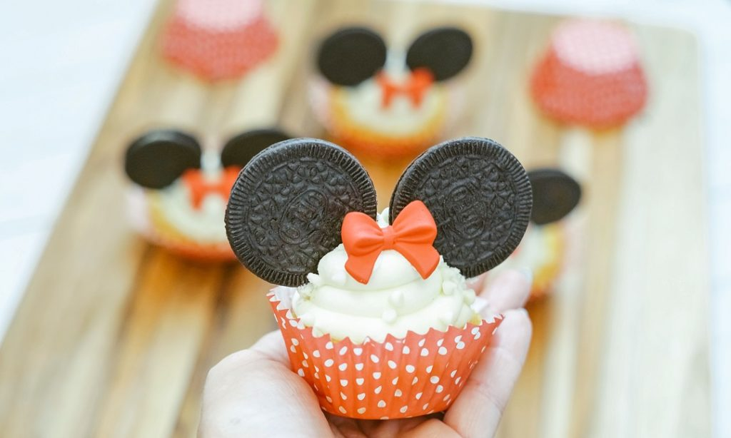 Minnie Mouse cupcake using Oreo Thins and Wilton red candy bow.