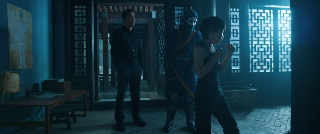 (L-R): Wenwu (Tony Leung), Death Dealer and Young Shang-Chi (Jayden Tianyi Zhang) in Marvel Studios' SHANG-CHI AND THE LEGEND OF THE TEN RINGS. Photo courtesy of Marvel Studios. ©Marvel Studios 2021. All Rights Reserved.
